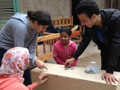 Fatma learning about building flower-beds.